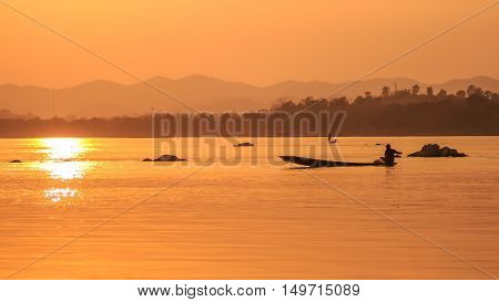 life of asian river at golden evening