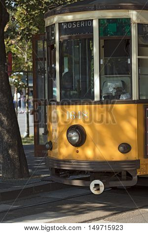 Detail of an old and vintage orange tram in a street in the city center in Milan (Milano) Lombardy Italy Europe