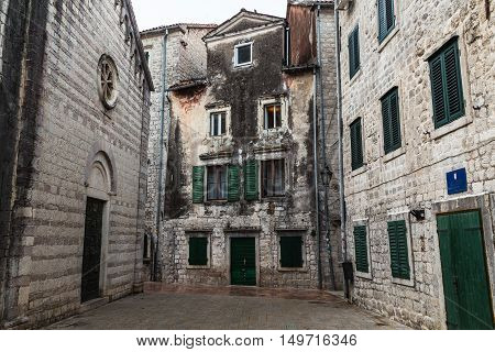 KOTOR MONTENEGRO - 13TH AUGUST 2016: Streets of Old Town Kotor during the day showing the outside of buildings.