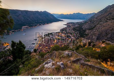KOTOR MONTENEGRO - 12TH AUGUST 2016: A view of the Kotor Skyline in Montenegro at night. Showing the glow of buildings and boats on the water.