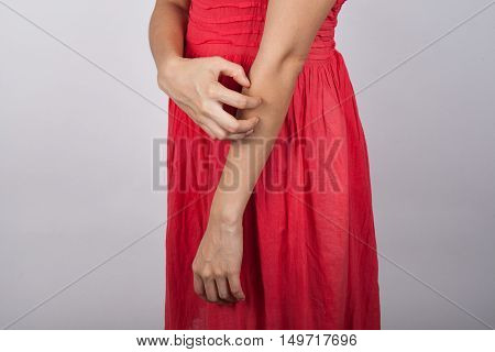 a woman has a itchiness on a white background