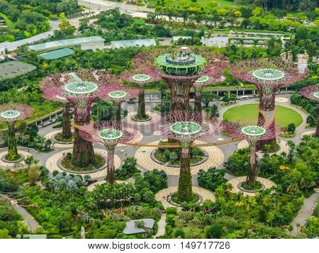SINGAPORE, REPUBLIC OF SINGAPORE - JANUARY 09, 2014: Singapore city skyline. Aerial view of Supertree Grove, Gardens by the Bay, Singapore
