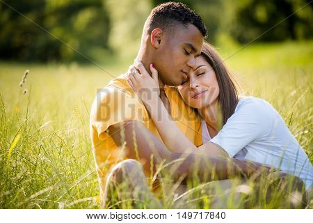 Young couple relaxing and daydreaming together - outdoor in nature