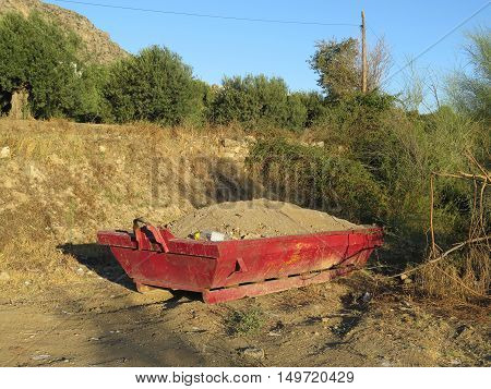 Full red builders skips on wasteland near Alora Andalusia