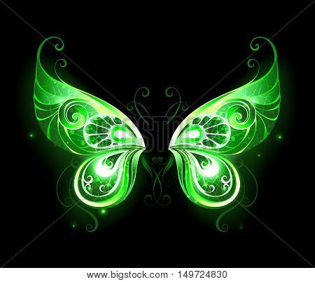 Patterned green glowing fairy wings on a black background. Magic symbol. Fairy Wings.