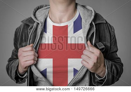 Man showing Great Britain flag on t-shirt. Concept for patriotism freedom and national pride.