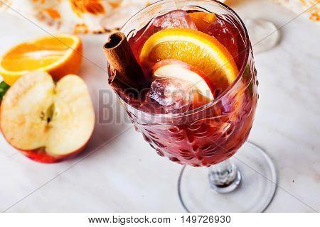 mulled wine, apple cinnamon, orange, chilled, ice close-up grog sangria top