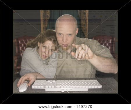 Man And Woman At Computer