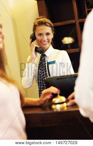 Picture of pretty receptionist answering phone