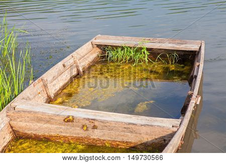 abandoned wooden fishing boat filled with water