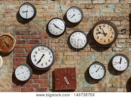 Old broken house wall and street clock on a brick wall. Background