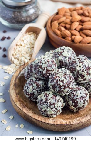 Healthy homemade paleo chocolate energy balls with rolled oats nuts dates and chia seeds vertical