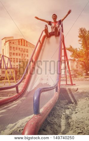 Slide detail in park. Enjoyment and happiness concept.