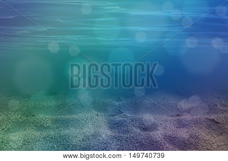 Underwater sea background with sandy sea bottom
