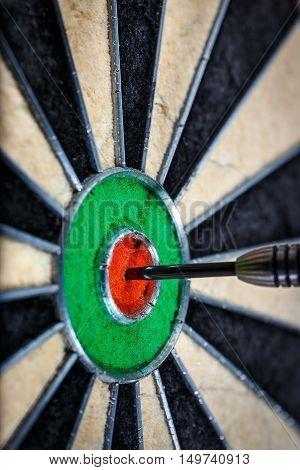 one dart in bull's eye close up