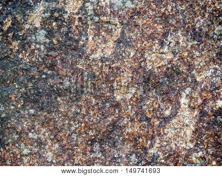 Earthy granite texture or background containg noce brown tones