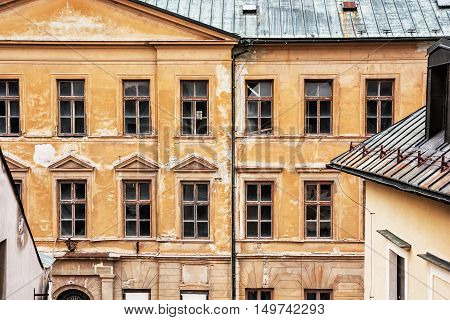 Old abandoned house in Banska Stiavnica Slovak republic. Architectural theme. Ancient building. Cracked wall. Impaired statics. Broken windows.