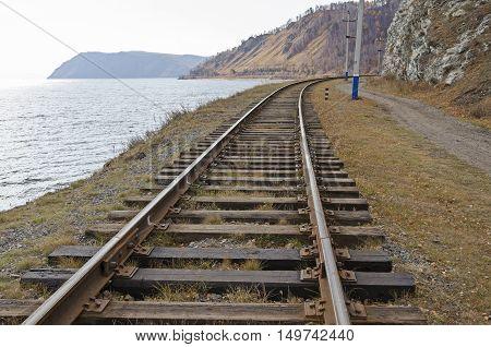 Section Of Circum-baikal Railway. Rail-track Running Near The Lake Baikal