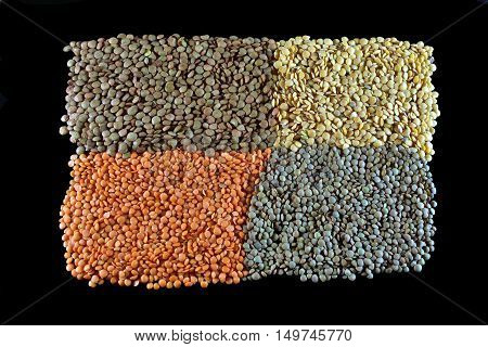 Varied diferent lentils ,mixed in the studio table. Isolated.
