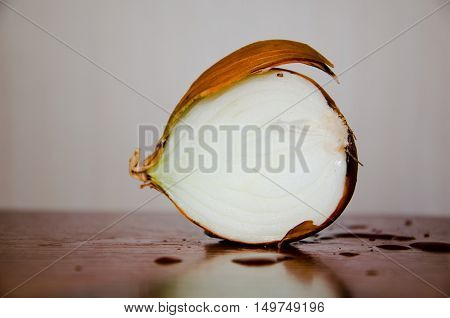 Fresh onions. Onions background. Ripe onions.Ripe onion on wooden background