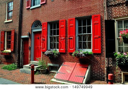 Philadelphia Pennsylvania - June 25 2013: 18th century olonial brick home with red fan doorway dating from 1703-1736 on historic Elfreth's Alley