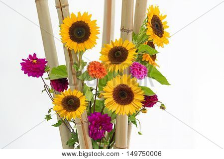 Floral Arrangement With Pink Dahlias, Sunflowers And Bamboo