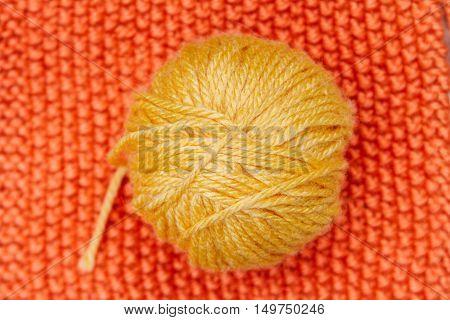 Yellow Ball Of Wool On Orange Cloth Woven Wool
