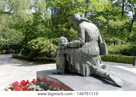 KOLOBRZEG POLAND - JUNE 22 2016: Statue of the woman who cares for a wounded soldier is a tribute to the women who fought during World War II for the Homeland's liberty in the ranks of Polish Army