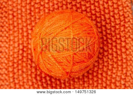 Orange Ball Of Wool On Orange Cloth Woven Wool