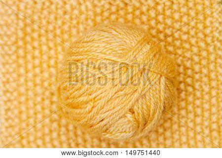 Yellow Ball Of Wool On Yellow Cloth Woven Wool