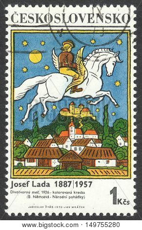 MOSCOW RUSSIA - CIRCA SEPTEMBER 2016: a stamp printed in CZECHOSLOVAKIA shows a paintings by Josef Lada the series