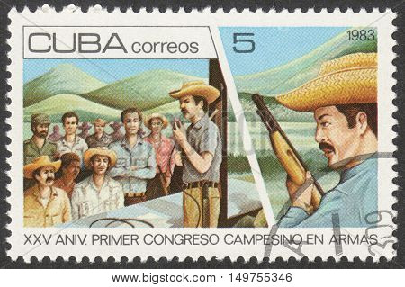 MOSCOW RUSSIA - CIRCA SEPTEMBER 2016: a stamp printed in CUBA dedicated to the 25th Anniversary of The Peasants in Arms Congress circa 1983