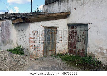 A old white fashioned concrete brick warehouse