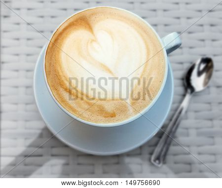 Delicious cappuccino coffee cup with cream froth