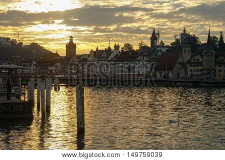 Sunset View Of Pier. Lucerne Lake And Old Town At Background. Lucerne, Switzerland