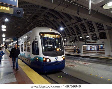 SEATTLE - JUNE 24: People exit Sound Transit light rail train inside Pioneer Square station taken Seattle Washington on June 24 2016.