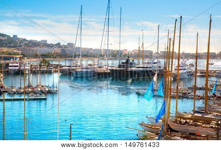 CANNES, FRANCE - 19 SEPTEMBER, 2016:   Old Port Vieux Port in the city of Cannes at sunset. Lots of sailing boats and power yachts anchored during the Sailing regatta.