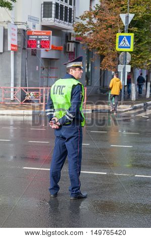 SAMARA RUSSIA - SEPTEMBER 10 2016: Russian police patrol officer of the State Automobile Inspectorate regulates traffic on city street