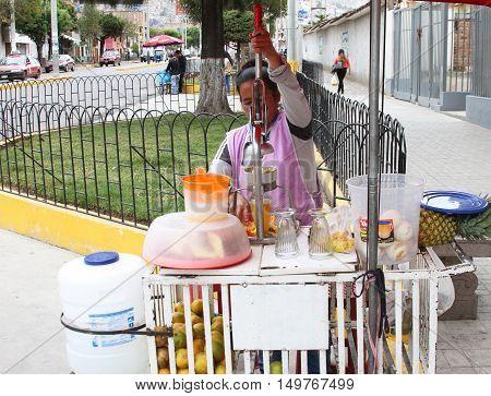 Cajamarca Peru - September 25 2016: Woman sells fresh-squeezed juice on the street in Cajamarca Peru on September 25 2016