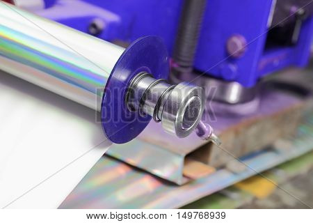 Paper roll in printing house. Close-up part of machine