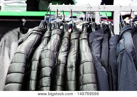 Fashion clothes store. Clothes on hanger in the shop
