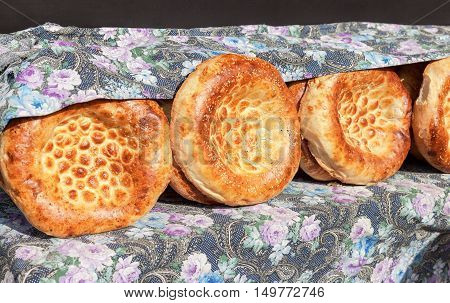 Traditional uzbek flatbread with sesame seeds from the tandyr