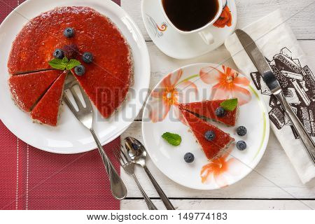 Strawberry dessert decorated with berries and mint leaf