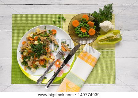 soy meat with vegetables and pepper on a green napkin