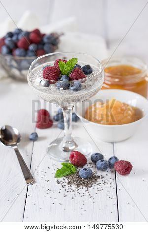 Sweet mousse with chia seeds and berries raspberries and blueberries