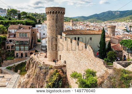 Towers of medieval fortification wall in Tossa de Mar, Costa Brava, Spain. Photo taken on sunny day.