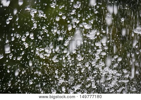 Levitation on green nature background of water drops