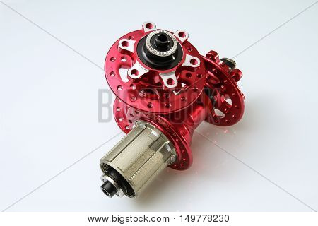 CNC machined mountain bike hubs (front and rear) painted red on an isolated white background