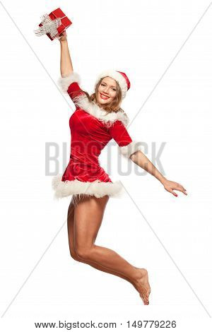 christmas, x-mas, winter, happiness concept - smiling woman in santa helper hat with gift box, happiness jump for joy isolated on White Background.