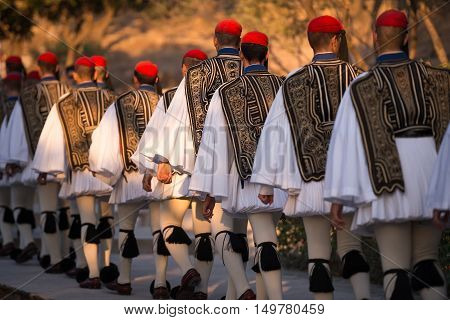 Athens Greece - August 28 2016: Lineup of soldiers dressed as Evzones or Presidential Guard marching to Acropolis of Athens Greece. The uniform is catching everybody's eye.